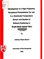 Development of a high frequency broadband photodetector for use in a distributed temperature sensor and studies of Brillouin scattering in single-mode optical fibre